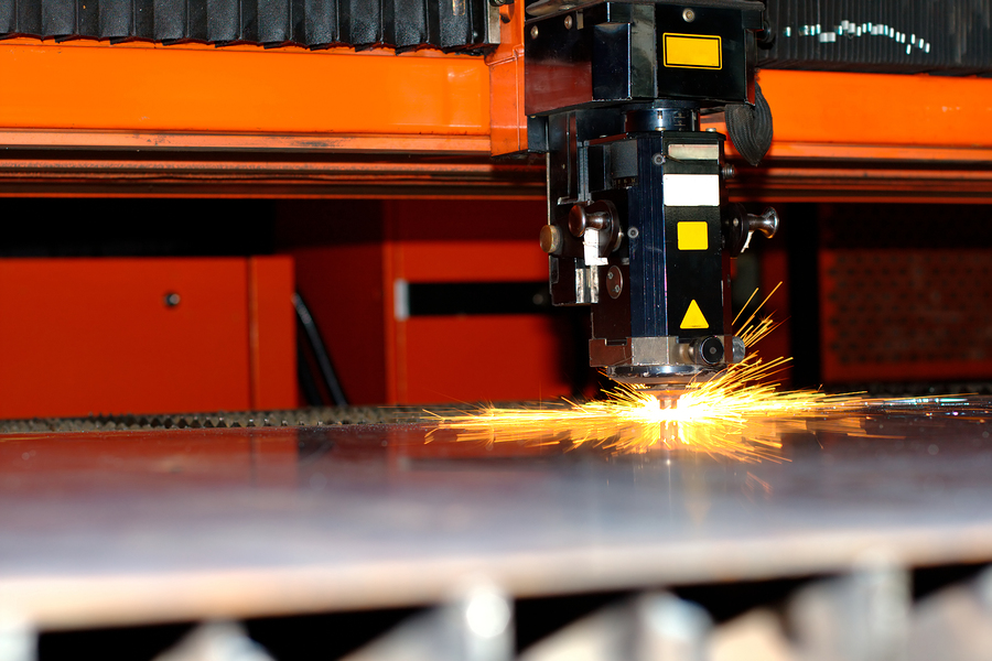 Photo of the industrial laser with sparks flying around